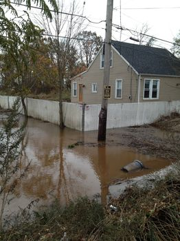 Down the block from Tasina, a home still under water.