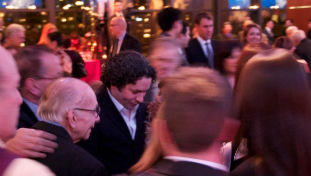 Gustavo Dudamel greets music industry executives at the Musical America awards ceremony Thursday night at Lincoln Center. To his right is José Antonio Abreu.