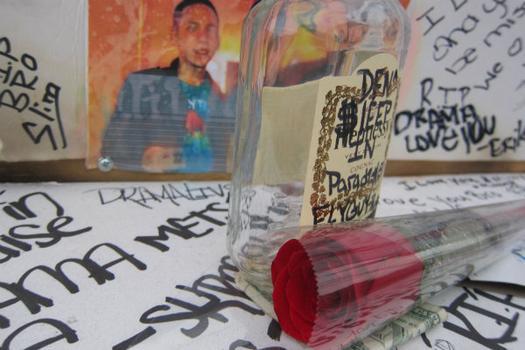 Items left behind on the street memorial honoring Jorge.