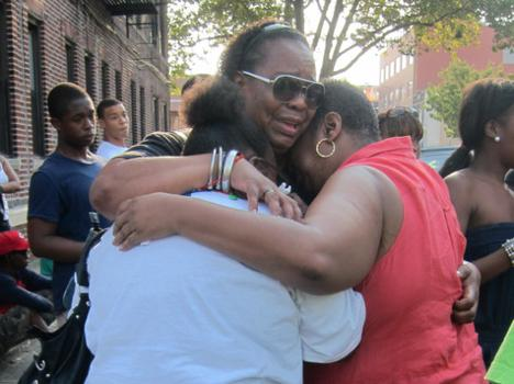 Relatives comforted each other at Ronald's vigil.