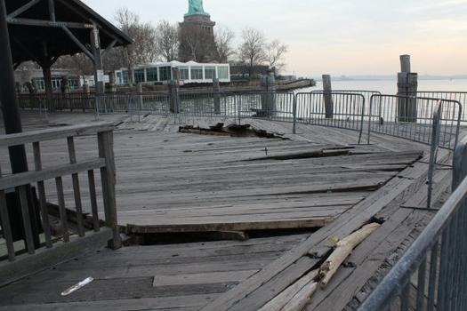 The passenger ferry dock was also damaged with boards lifted out of place.