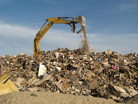A crane sorts the debris pile at Jacob Riis.