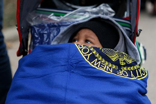 Child wrapped in blanket at Hammel Houses in Far Rockaway, Queens after Sandy.