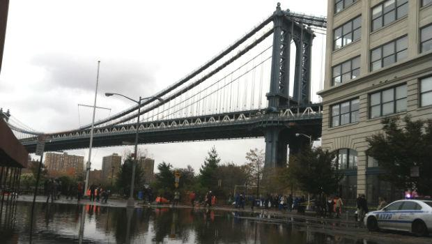 Workers began cleaning the streets of Dumbo in the aftermath of Hurricane Sandy