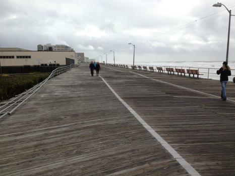 Residents stroll along the boardwalk after Sandy.