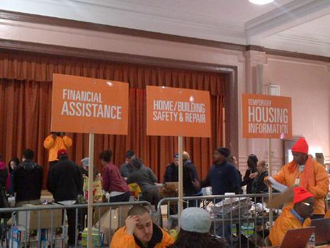 Large orange signage points out some of the various services at Coney Island Restoration Center