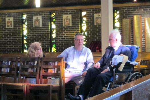 Leslie Granowski and Stuart Chambers sitting with their former neighbor James McCormick before the funeral mass.