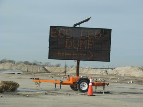 A sign leading into the staging ground at Jacob Riis Park, where much of New York City's Sandy debris is collected.