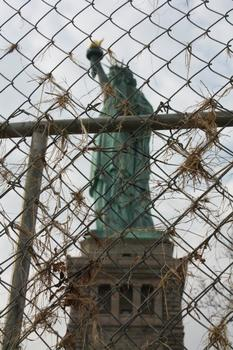 Debris from the flooding remains on the fence near the statue.