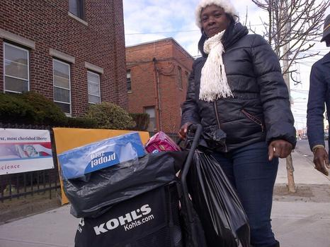 46 year old Darlene Wright leaving the Coney Island Restoration Center on West 19th street with a basket full of supplies