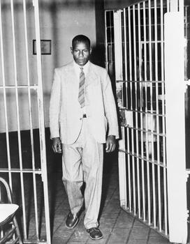 "Clarence Norris, one of the nine defendants in the ""Scottsboro case"", walks through the main cell gate at Kilby prison in Montgomery, Alabama, after receiving his parole in 1946."