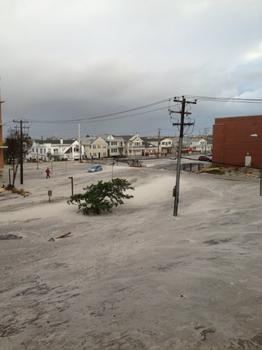 Sand covers the streets, and a parking lot in the West End, Long Beach, NY.
