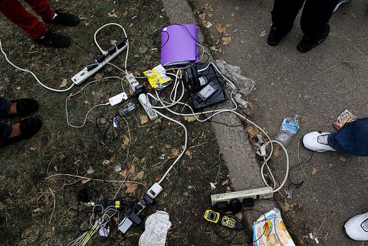 Charging cell phones at Hammel Houses in Far Rockaway, Queens.