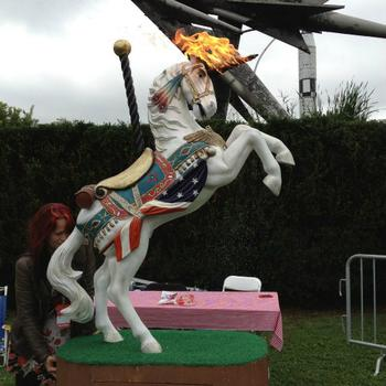 Katy Perry, the unicorn, shoots flame from her horn, glitter from her nose and pees a beverage of your choice. (At Maker Faire, it was only water.)