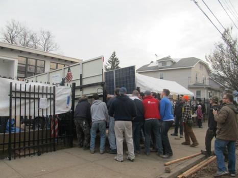 Volunteers had to manuever the trailer into the gates and behind the building, where the solar generator was placed for maximum sunlight.