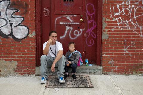 Andy with his daughter, Jolena, in the same doorway where Brenda first photographed him.