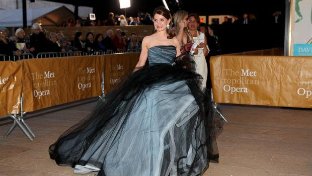 A patron arrives on the red carpet at the Metropolitan Opera's opening night