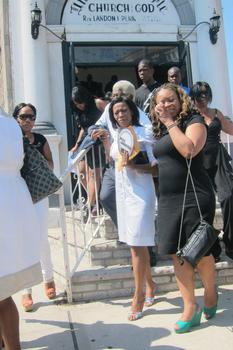 Mother Tiffany Orr & Grandmother Donna Orr after the funeral service at Universal Temple Church of God in Brownsville.