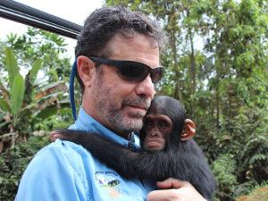 Richard Ruggiero with a 6-month old chimp confiscated from poachers who were trying to sell the chimp on a road in Gabon.