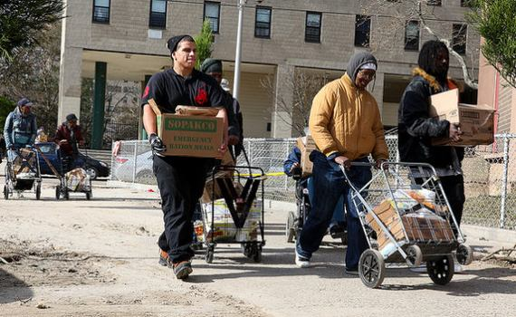 Coney Island residents get supplies from National Guard.