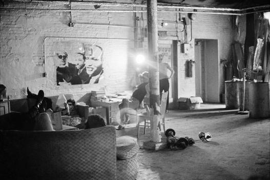 Lou Reed on the sofa, Joseph Freeman with back to camera, and Andy Warhol in the Silver Factory, 1966.
