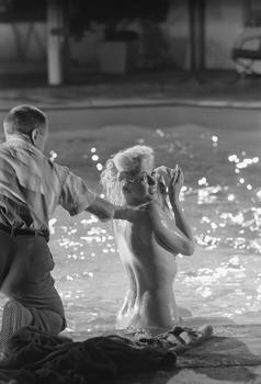 "Marilyn Monroe in between set-ups at the pool at 20th Century Fox on May 23, 1962, on the movie set of ""Something's Got to Give.""  The set was a replica of director George Cukor's home."