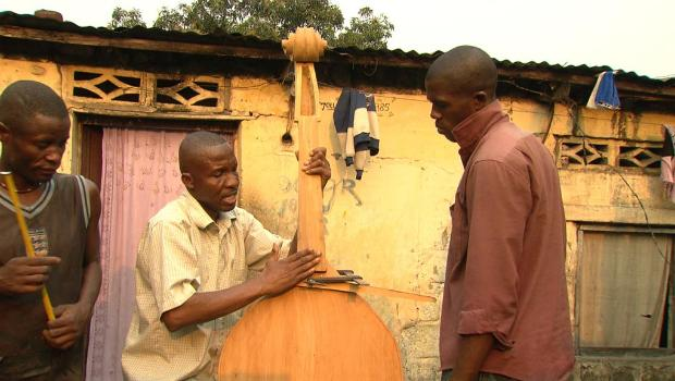 Albert Nlandu Matubanza, orchestra manager making a double bass.