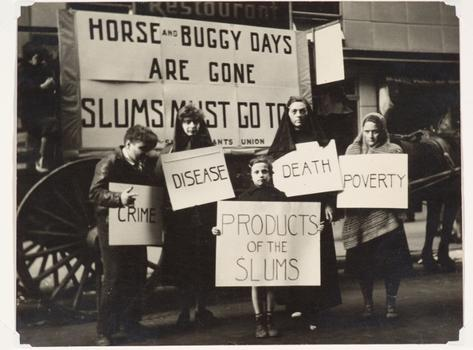 Cardboard signs ain't new: Seen here, an image by Joe Schwartz from c. 1936, from a Mayday parade in New York.