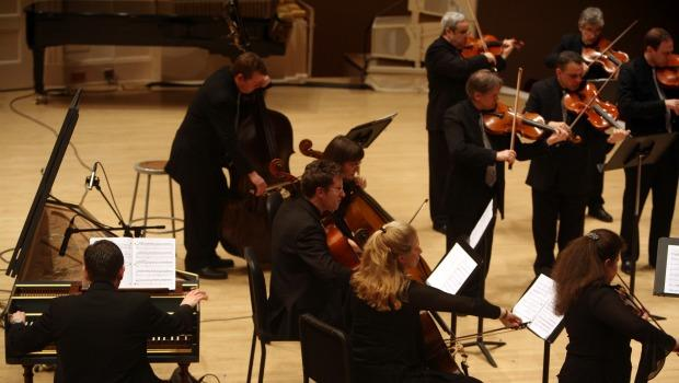 String players of Orpheus stand while playing Christopher Theofanidis's 'Muse' during the Orpheus concert Friday night.