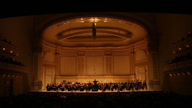 The Albany Symphony Orchestra takes the stage at Carnegie Hall to perform a program of American spirituals.