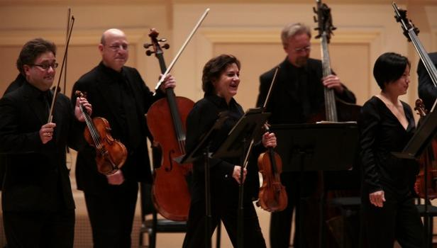 The violinists and violist of the St. Paul Chamber Orchestra stood to play Stravinsky's Concerto in D for strings