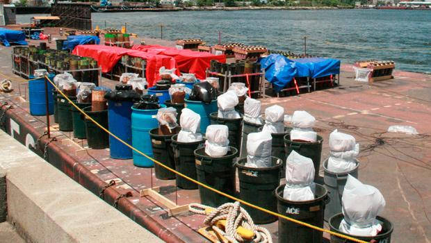 Coded by size, color and time of release, packaged firework shells line one of the six barges.