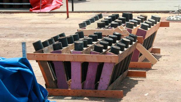 Specially-designed mortars hold a set of pink fireworks.