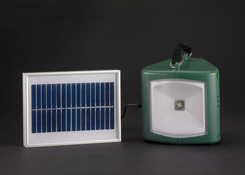 Solar-powered lamp and charger.
