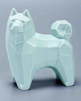 An affinity for modernism in 1920s Japan also translated into streamlined decorative objects, such as this 1930s porcelain sake flask in the shape of an Akita.