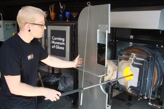 A GlassLab glassmaker heats glass in an annealing oven.