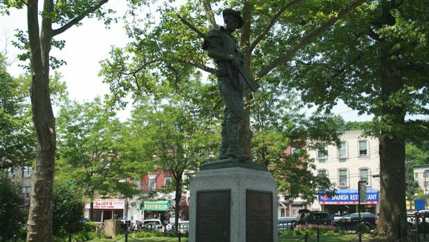 "The team also cleaned Allen Newman's 1916 ""The Hiker"" In Tompkinsville Park."