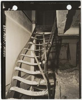 [Steel stairs warped by intense heat from burned book stacks of Asano Library, Hiroshima], November 15, 1945.