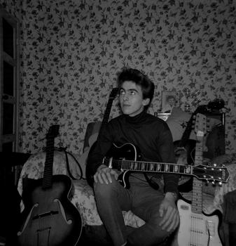 George Harrison at home at Upton Green with guitars