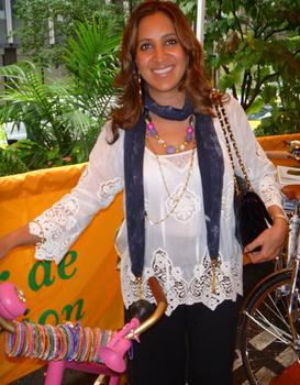 Amrita Singh poses alongside her bike.
