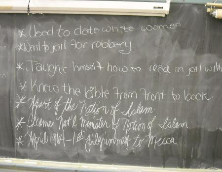 The blackboard in Lauretta Crawford's classroom, where students study <em>The Autobiography of Malcolm X</em>.