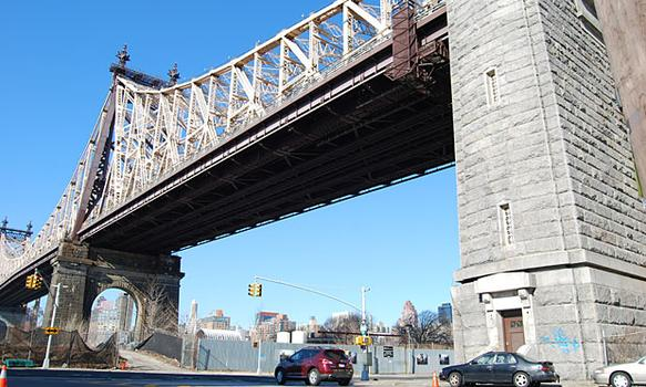 The outdoor exhibit sits under the Ed Koch Queensboro Bridge, at the junction of Vernon Boulevard and South Queens Plaza.