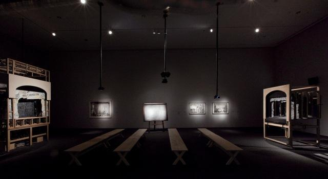 """Installation view of """"Black Box/Chambre Noire,"""" """"Learning the Flute,"""" and """"Preparing the Flute"""" (L to R). Art by William Kentridge. Music by Philip Miller. 2005, 2003, and 2005."""