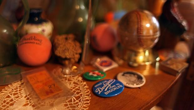 Pieces of Brooklyn's past: Spalding, Brooklyn Dodgers ticket, a baseball from the last Dodgers game and various pins
