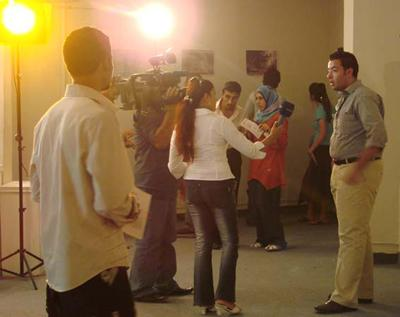 An an art opening draws a crowd, and the media, at the Madarat Gallery in Baghdad. Sept 2007