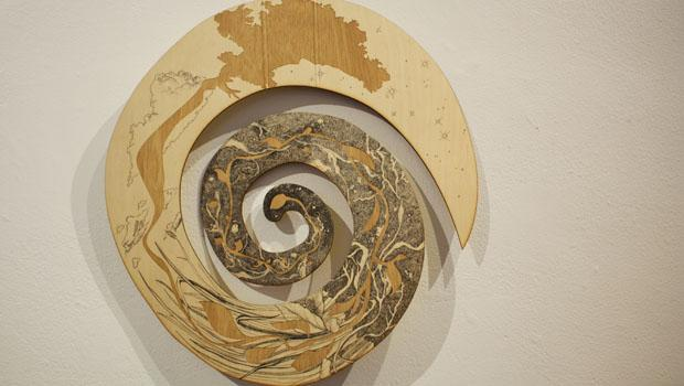 """Man's Potential Over Time"" by Abigail Malate; lauan plywood, ink"