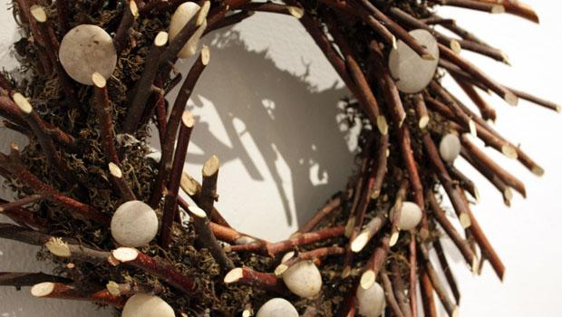 """Sticks and Stones"" by John Clarke; birch and crabapple branches, moss, foam, white stones, roofing nails"