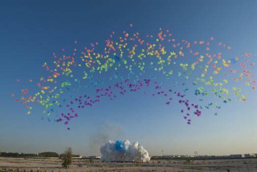 Another video documents a fireworks show by Chinese artist Cai Guo-Qiang, which incorporates the use of pigments. Seen above: a photograph of his work 'Black Ceremony,' executed in Doha last year.