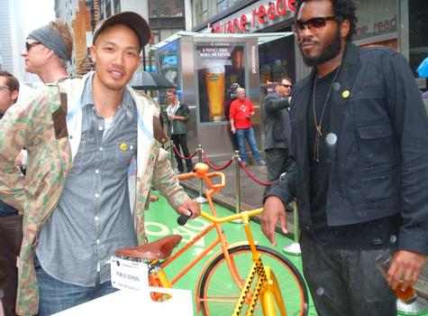 Dao-Yi Chow and Maxwell Osborne stand by a bike made by their group, Public School, which turned to yellow cabs for inspiration.