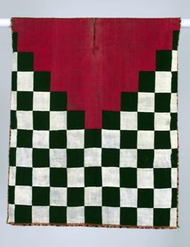 An Inca-style checkerboard tunic from Peru's Nazca Valley, from 1470-1540. The Incas were known for eschewing elaborate representations in their weavings, opting for simple geometric designs.